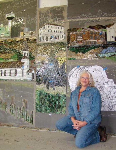 092417.N.GFH.BADGERART-Sherri Kruger in front of wall