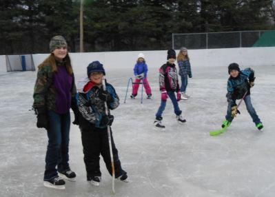 Kids enjoy the outdoor at ice rink at Wannaska's Rink and Rec park